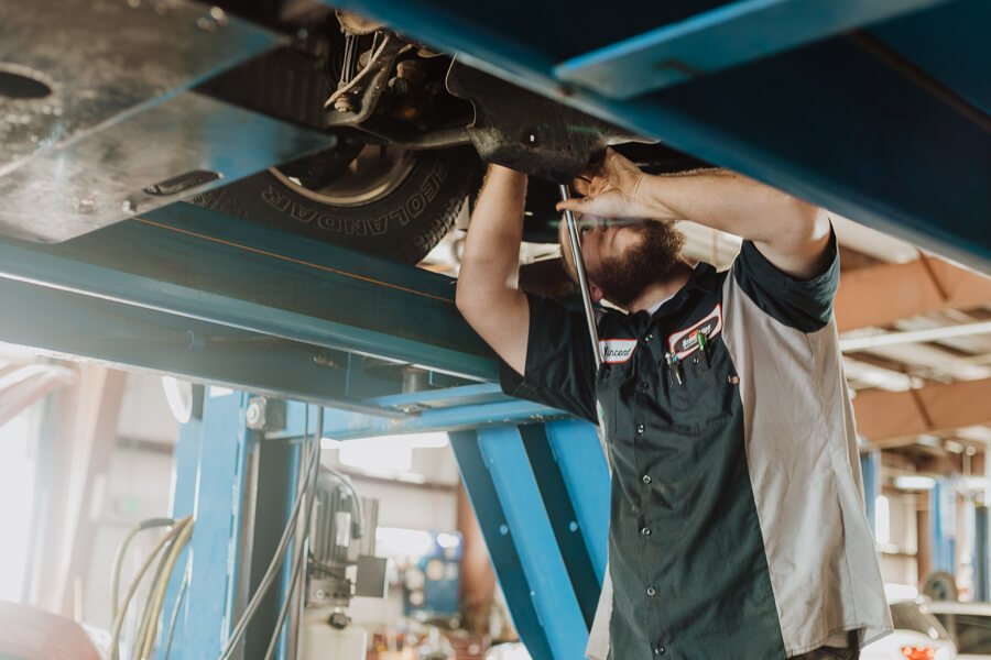 Auto Technician Repairing Vehicle Brakes at BA Auto